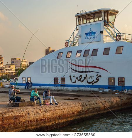 Port Fuad, Egypt - November 10, 2018: Local Citizens Of Port Fuad District Fishing Beside Port Said
