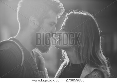 Couple With Smiling Faces Stand Close, Looks With Tenderness. Love And Kiss Concept. Couple In Love