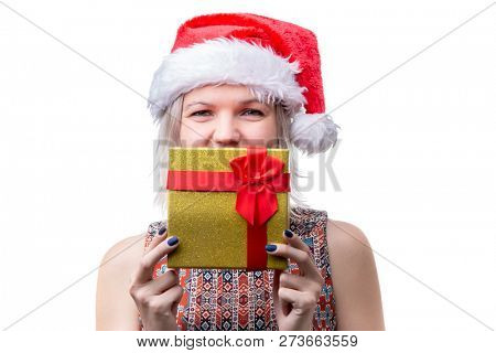 Image of blonde in glasses and Santa's cap with gift in hand