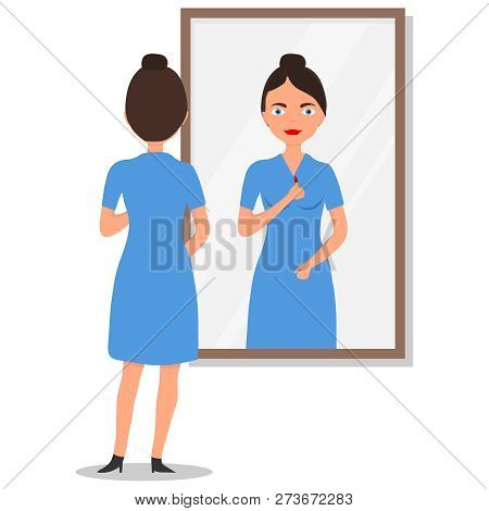 Young Long-haired Woman Standing In Front Of Mirror And Looking. Woman Standing And Looking In Mirro