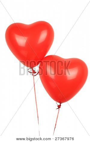 two red heart balloons on a white background
