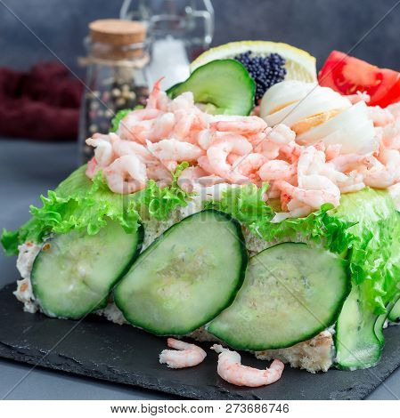 Traditional Savory Swedish Sandwich Cake Smorgastorta With A Bread, Shrimps, Eggs, Caviar, Dill, May