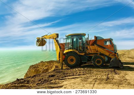 Earthworks to strengthen the coastline in the South of Ukraine.Elimination of soil erosion. poster