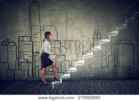 Side View Of Young Businesswoman Climbing Career Ladder Against Cityscape Being Professional Real Es
