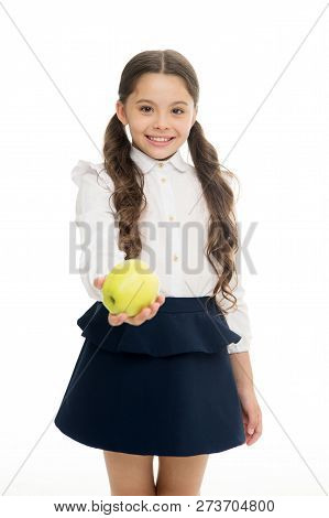 Girl Cute Pupil Hold Apple Fruit Stand On White Background. Kid Happy Hold Apple. School Snack Conce