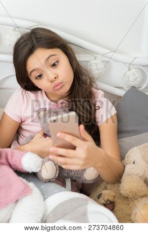 Happy Childhood. Girl With Smartphone Use Modern Technology. Selfie With Favorite Toy. Send Selfie P
