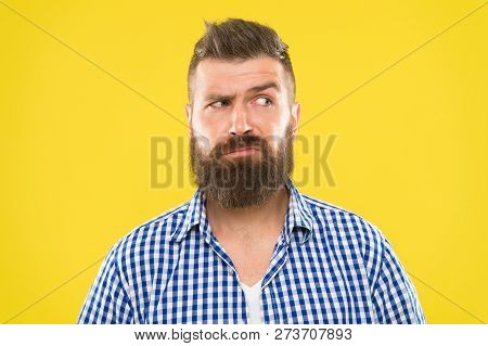 Man Serious Face Raising Eyebrow Not Confident. Have Some Doubts. Hipster Bearded Face Not Sure In S
