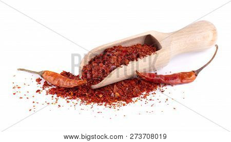 Dry And Crushed Chili Pepper Flakes Isolated On White Background. Red Chili Peppers In A Wooden Spoo