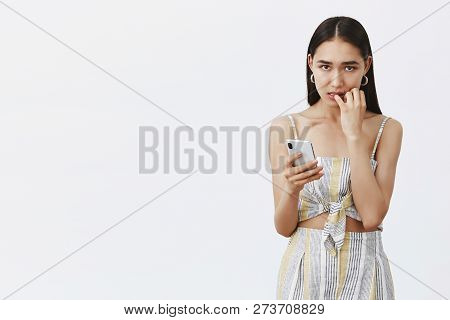 What Should I Do, Help. Portrait Of Worried Charming Tanned Girl With Dark Hair, Biting Fingernails