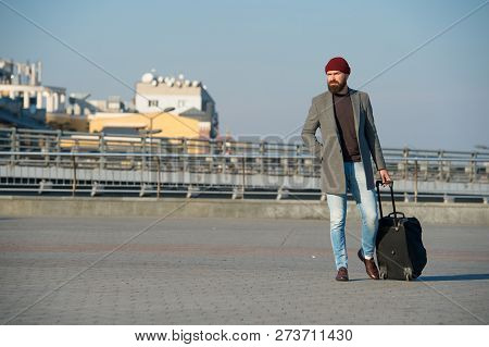 Hipster Ready Enjoy Travel. Carry Travel Bag. Man Bearded Hipster Travel With Luggage Bag On Wheels.