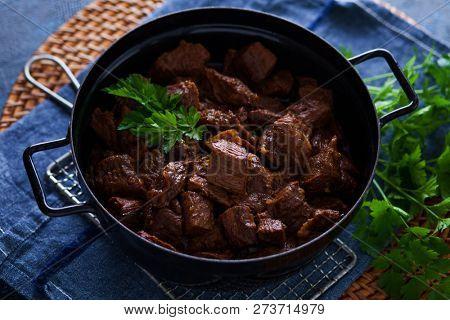 jug of goulash beef stew with herbs - food and drink