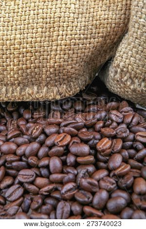 Coffee Beans In Burlap Sack Color Image Stock Photos