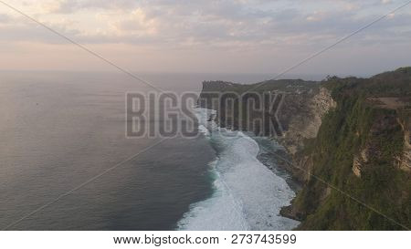 Aerial View Rocky Ocean Coastline At Sunset. Seascape Waves Break On Rocky Shore Travel Concept.