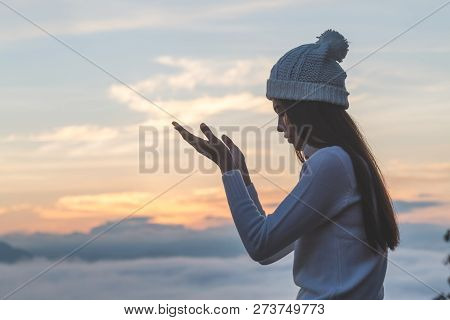 Young Christian Woman  Hands Open Palm Up Worship And Praying To God  At Sunrise, Christian Religion