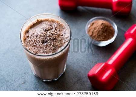 Chocolate Protein Shake Smoothie With Whey Protein Powder And Red Dumbbells