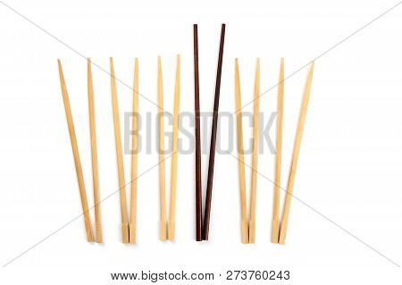 Many Pairs Of Chopsticks On A White Background With One Of Them Obviously Larger And Better Than The