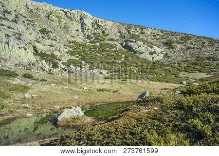 Glacial Lagoon Next To The Pico Del Nevero (snowfield Peak; 2.209 Metres), In Guadarrama Mountains N