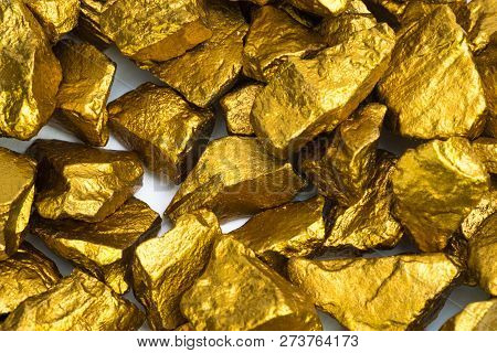 A Pile Of Gold Nuggets Or Gold Ore On White Background, Precious Stone Or Lump Of Golden Stone, Fina
