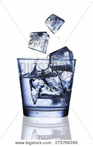 Splash Ice Cubes Into A Water Glass