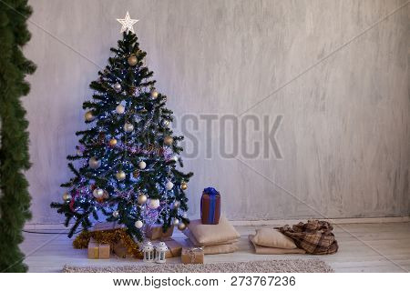 Christmas tree with lights garlands adorned with new year holiday gifts poster