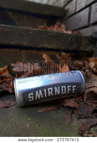 Bracknell, England - December 13, 2018: Discarded Tin Can Of Smirnoff Vodka And Cola Drink On Concre