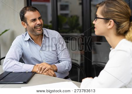 Cheerful Mid Adult Hr Manager Having Interview With Candidate. Caucasian Male Manager Talking To Fem