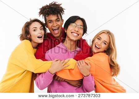 Group of cheerful teenagers isolated over white background, hugging