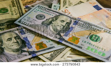 Background With Money. Us Dollar. American Hundred-dollar Bills. Euro Banknote. One Hundred Dollars.