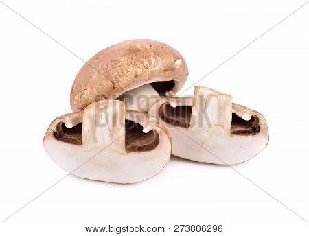 Whole And Half Cut Fresh Champignon Mushrooms On White Background