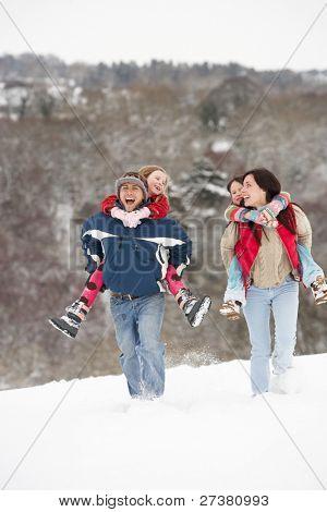 Family Having Fun In Snowy Countryside