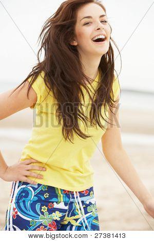 Happy Teenage Girl Having Fun On Beach