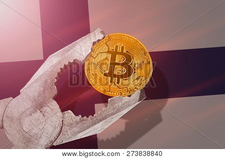 Bitcoin (btc) Coin Being Squeezed In Vice On Finland Flag Background; Concept Of Cryptocurrency Bitc