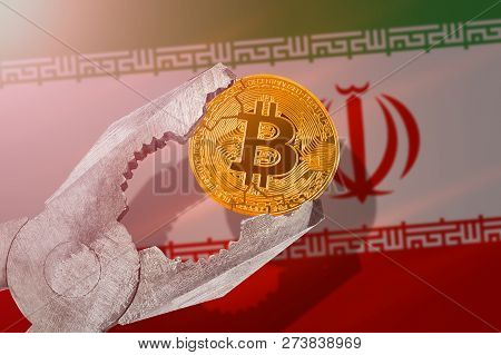 Bitcoin (btc) Coin Being Squeezed In Vice On Iran Flag Background; Concept Of Cryptocurrency Bitcoin
