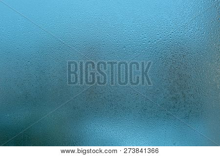 Misted Glass Background. Strong Humidity In Wintertime. Water Drops From Home Condensation On A Wind