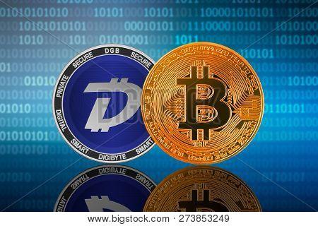 Bitcoin (btc) And Digibyte (dgb) Coin On The Binary Code Background; Bitcoin Vs Digibyte