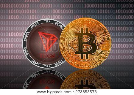 Bitcoin (btc) And Tron (trx) Coin On The Binary Code Background; Bitcoin Vs Tron