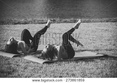 Energy, Energetic, Activity. Sexy Women Athletes Do Yoga Exercises, Training. Sport, Yoga, Pilates,