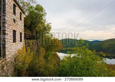 Autumn colours on display in the Carso karst limestone area of Friuli, near Lago di Doberdo lake in north east Italy. Casa Cadorna, a World War One ruin, is on the left poster