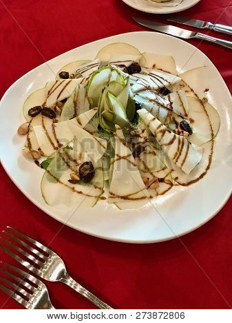 An Amazing Pear, Pecorino Cheese, Arugula And Toasted Walnut Salad With Balsamic Glaze In A Fine Din