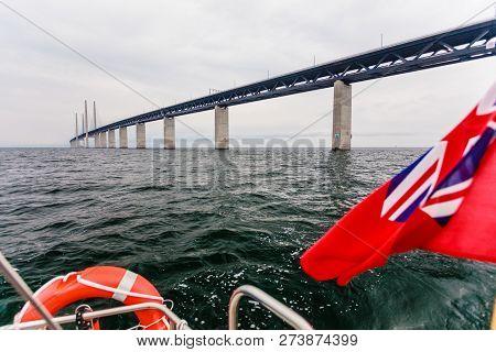 Oresundsbron. The Oresund bridge link between Denmark and Sweden, Europe, Baltic Sea. View from sailboat yacht under uk british ensign. Traveling. poster