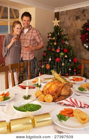 Young couple at home at Christmas