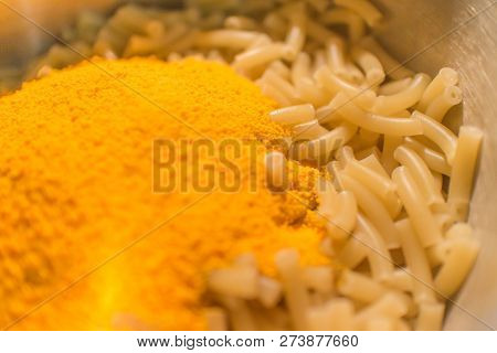Macaroni Noodles With Powdered Cheese In A Metal Cooking Pot.