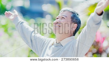 Old Man Feel Carefree And Take A Deep Breath In The Park