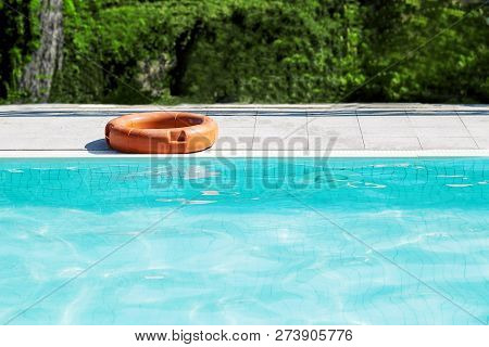 A Life Buoy For Safety On The Edge Of Pool