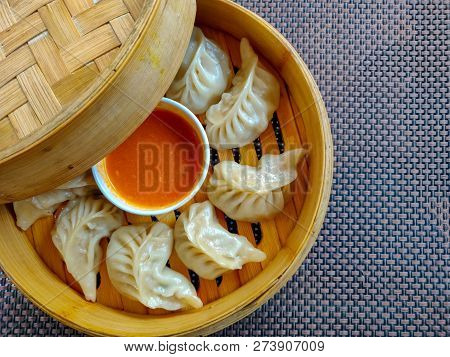 Chicken Momo Served In A Wooden Box. Top View