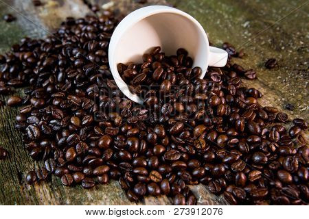 Coffee. Coffee Beans. Coffee Cup Full Of Coffee Beans. Coffee Beans In A White Mug
