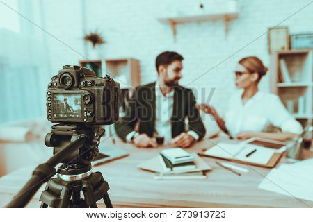 Blur Image Of Journalist Is Interviewing A Businessman. Journalist Using A Dictaphone. Camera Shoots