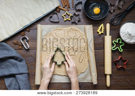 Homemade Christmas Cookies On Parchment. Woman Rolls Dough. Xmas. The Process Of Baking Homemade Coo