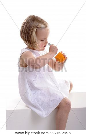 Little Girl Eating Yoghurt