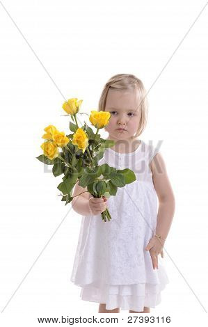 Sad Looking Little Girl With Bouquet Of Yellow Roses